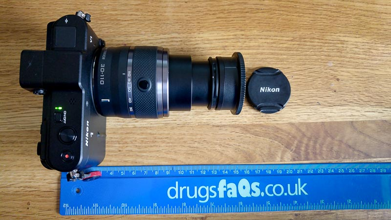 Nikon 1 V1, 30-110mm lens and Raynox adapter, total length 150mm