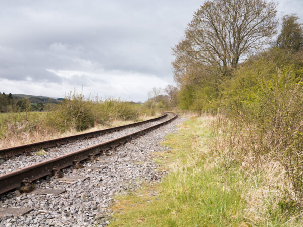 Railway track curving into distance